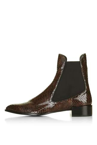 This classic chelsea boot is updated with snakeskin texturing